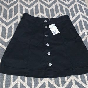 black denim skirt with buttons